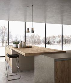 Barra de cocina con diseño rectangular muy actual en madera y simplemente apoyado en dos muebles.