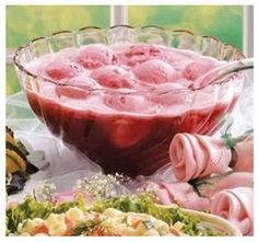 """Champagne Wedding Punch   In a punch bowl add 1/2 gallon of sherbet, 2 bottles of Sprite or 7-up and a bottle of your bargain priced champagne.  These three ingredients together, create a frothy """"Punch in a Cloud"""" look.   When you are trying to match wedding colors, substitute raspberry for pink, lime for green, daiquiri for blue or pineapple sherbet for yellow or with a dash of food color in your pineapple sherbet for any color you choose."""