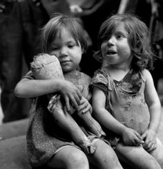David Seymour ITALY. Naples. Playing with something that was once a doll. 1948.