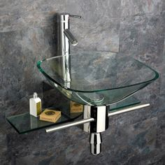 Now thats fancy. Wall Mounted Glass Basin! Perfect for a small powder room.