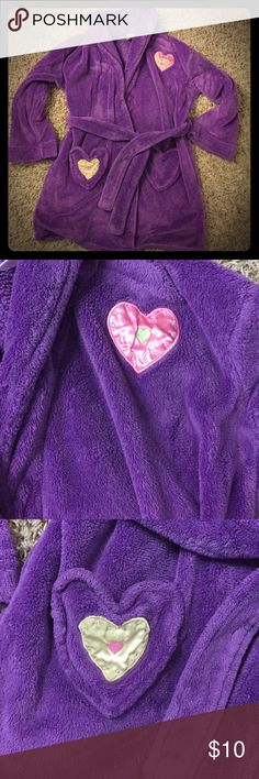 Girls M purple fluffy bathrobe Super cozy purple fuzzy bathrobe for your little lady.  Bathrobe has heart shaped pockets, an outer belt and an inner tie to help secure it closed.  100% polyester. Xhilaration Pajamas Robes