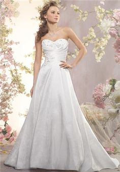 Strapless taffeta and re-embroidered lace a-line gown with a draped natural waist bodice. The crystal beaded lace accents the bodice, while the pockets and a sweep train finish the skirt.