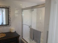 Bathroom with tiled walls and vintage vanity