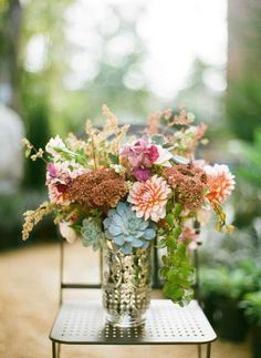 Bridesmaid bouquets: love the blue flower in this--succulents?? incorporate into the coral flower arrangements in the other pictures? i don't like this whole bouquet as much, just the blue flower.