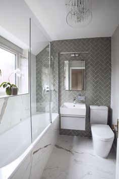 Small bathroom does not have to be boring. One of my favorite bathroom projects! … Small bathroom doesn't need to be boring. One of my favourite bathroom projects! Love the combination of herringbone and marble effect tiles in this bathroom, which togethe Modern Bathroom Design, Bathroom Interior Design, Ideas Baños, Decor Ideas, Decorating Ideas, Tile Ideas, Gray And White Bathroom, Small Bathroom With Bath, Small Bathroom Ideas