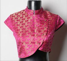 High Neck Brocade Blouse Get ready to get endless compliments in latest brocade blouse designs. Let us explore the world of sheer brocade in blouse. The brocade is made of premium quality and is highly comfortable to wear. Choli Designs, Brocade Blouse Designs, Brocade Blouses, Saree Blouse Patterns, Fancy Blouse Designs, Designer Blouse Patterns, Bridal Blouse Designs, Blouse Neck Designs, Dress Designs