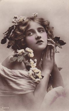 "1918..Beautiful Ivy Lillian Close with Flowers in Hair.  She won a contest for ""Most Beautiful Woman in the World"" in England and went on to star in films."
