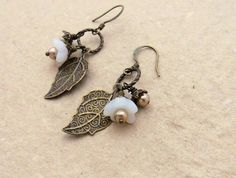 White Blossom Cluster earrings: pale, dainty glass flowers with buds and leaf charms on short hooks