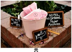 Idea: Paper Airplanes. Have the guest throw airplanes instead of rice