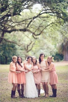 bridesmaids in boots, not digging the boots but I love the mismatched dresses