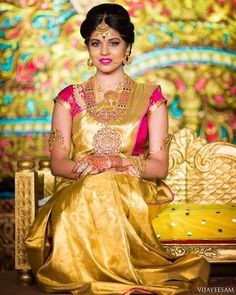 South Indian bride. Gold Indian bridal jewelry.Temple jewelry. Jhumkis. Red and yellow silk kanchipuram sari.Braid with fresh jasmine flowers. Tamil bride. Telugu bride. Kannada bride. Hindu bride. Malayalee bride.Kerala bride.South Indian wedding.