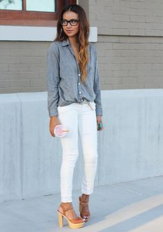 Summer Outfit Idea: White Jeans - chambray button-down shirt worn with low rise white jeans, chunky wooden heeled sandals, and chic black framed glasses