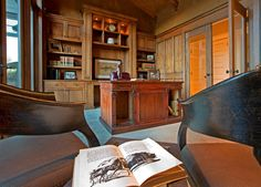 A stately home office with custom woodwork, plenty of space and natural lighting.  Sammamish, WA Coldwell Banker BAIN
