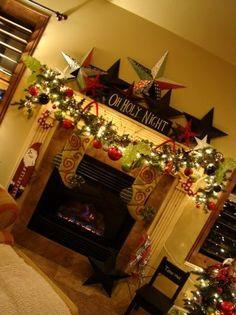 Decorated Christmas Mantle @Amanda Snelson Snelson Snelson Snelson Snelson Ables Look at all them stars!