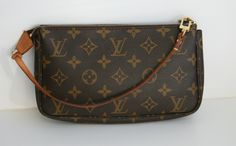 Louis Vuitton - Pochette Monogram . Great for when you dont want to carry larger bag. Great basic! I love my Lv's. Ive made some great purchases throughout the years!!