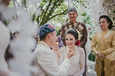Today, Bridestory is proud to celebrate Indonesia's 71st independence day. With its diverse culture, history, and of course wedding traditions, Indonesia has produced some of the most captivating celebrations we have ever seen. To honor this day, we've created a compilation of the most unforgettable moments from recent traditional Indonesian weddings. Click to feast your eyes upon them, we're sure you'll walk away feeling very much inspired.