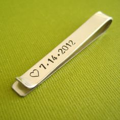Personalized Tie Bar in Sterling Silver - custom stamped tie clip - perfect groomsmen gift. $44.00, via Etsy.