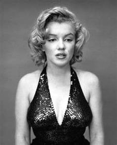 """Marilyn - Yousuf Karsh    Yousuf likes to find the real personality of a person in his portraits (a trait I took to myself) Marilyn apparently kept putting on her fake face all day until the shoot exhausted her.. leaving Yousuf a moment to capture this picture of her """"true"""" face."""