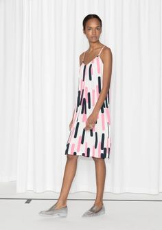 With a strappy front and a covered back, this free and easy viscose dress is accented with diagonally placed pleats for soft volume with a romantic swing.