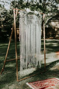 macrame ceremony backdrops - http://ruffledblog.com/lovingly-handcrafted-backyard-wedding-with-boho-details