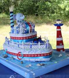 #Nautical theme #Diaper cake #blue #red #NauticalBabyShower #Itsaboy #lighthouse #seabase #elephantcaptain #seashells #stones