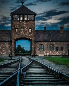 --- Photo by @theworldisbigandiwanttoseeit - --- Auschwitz II-Birkenau. The main guard tower of the camp.  From May 1944 the entrance gate for the trains who brought deported people to the camp.  The trains entered straight onto the unloading platform where SS doctors divided the Jews into a group of prisoners and a much larger group of those who were immediately murdered in gas chambers.