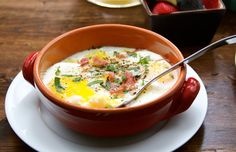 Baked eggs over Polenta with Prosciutto and Herbs