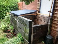 Wonderful compost containers made from railway sleepers, still going strong after 30years but we need more than 2m2
