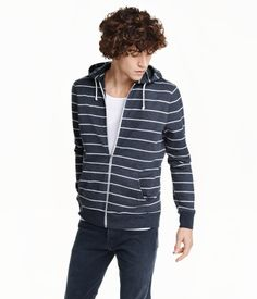 Sweatshirt jacket with a jersey-lined drawstring hood. Zip at front, front pockets, and ribbing at cuffs and hem.
