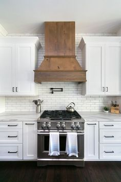 White and Wood Modern Farmhouse Kitchen with White Cabinets and Wood Range Hood . - White and Wood Modern Farmhouse Kitchen with White Cabinets and Wood Range Hood - Farmhouse Kitchen Cabinets, Farmhouse Style Kitchen, Modern Farmhouse Kitchens, Home Decor Kitchen, Home Kitchens, Kitchen Ideas, Farmhouse Decor, Kitchen Modern, Farmhouse Ideas