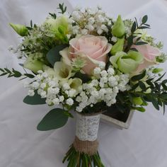 Hand-tied bouquet of gypsophila, Sweet Avalanche rose, lisianthus, freesia, astrantia and eucalpytus.