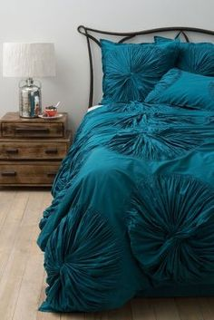 I love this color. If only I could find it in a dress vs. bedding.