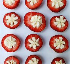 Cute appetizer/snack idea!  Cream cheese filled strawberries.