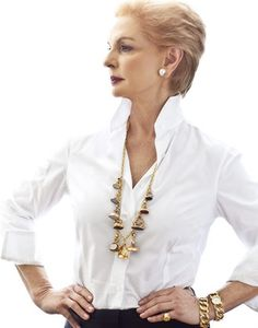 Total Class - Carolina Herrara I like the watch fob necklace and crisp white shirt.