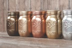 Painted mason jars with Rustoleum metallic spray paint colors. Silver, gold, copper.