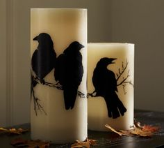 Flameless Raven Pillar Candle | Pottery Barn Idea for DT tall glass candles, modge podge & printed think paper.