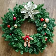A homemade wreath, using baubles, a spray painted Christmas flower, and hand-stitched gingerbread man! Homemade Wreaths, Gingerbread Man, Diy Wreath, Christmas Greetings, Christmas Wreaths, Flower, Inspiration, Crown Flower, Biblical Inspiration