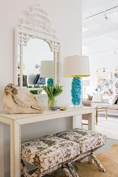 Can't get enough of this foyer by Linda Weinstein featuring our White Lacquer Pagoda Mirror! Click to buy!