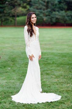Lace plunge neckline Berta wedding dress: http://www.stylemepretty.com/2016/12/15/best-wedding-dresses-of-2016/ Photography: Tamara Gruner - http://tamaragruner.com/