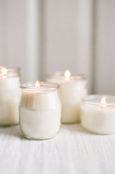 repurposed glass yogurt jars as candles.
