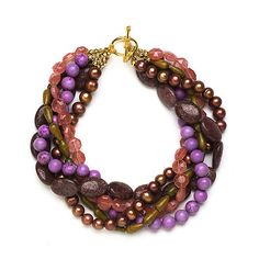 Multiple-Strand Beaded Necklace ~ Big beads make for a snappy necklace. For a knockout look, mix gemstones with smooth and faceted textures. Pick out the strands of big beads first, then mix them with strands in other shapes, sizes, and colors.