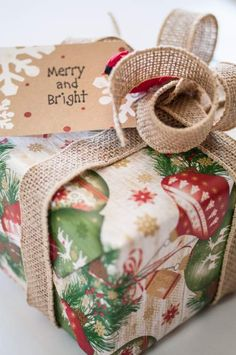 Christmas Wrapping Paper uses:  Current's Ornaments on Garland Wrap  Kraft To/From Tags  Burlap Ribbon A Red Cardinal