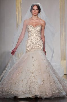 How can a bride resist this glamorous floor length wedding veil with gold trim from Lazaro?
