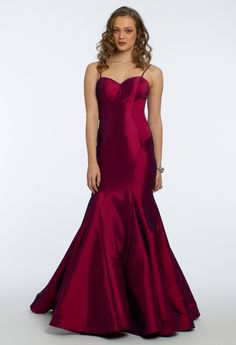Romance and fashion go hand in hand with this alluring evening gown: with its sweetheart neckline and spaghetti straps, fitted bodice, mermaid skirt and sexy lace up back, there's no denying that this wedding guest dress is the stylish staple you've been looking for. Pair it with rhinestone heels, multi stone earrings and a metallic sparkle clutch. #CamilleLaVie