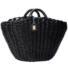 Dolce & Gabbana bag - this is a great example of a black bag...done differently. We are seeing a lot of unique shapes in hand bags at the moment!