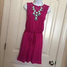 """✨B1G1 FREE✨LOFT Fuchsia Dress Gorgeous dress with unique cut out neckline that is in great condition. It has an elastic waistband with detachable sash. I am 5'4"""" and the length on me is 2 inches above the knee. Actual size is petite XS but fits like a typical XS to me. 65% polyester 35% viscose ✨Buy one item at list price and pick another equal or lower priced item for free-I can bundle them together for you✨If only interested in this item then feel free to make an offer✨ LOFT Dresses"""