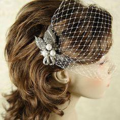 PAULINE - Vintage Inspired Bridal Hair Comb, Pearl and Rhinestone Art Deco Wedding Hair Comb, Bridal Hair Accessory, Leaf Wedding Hairpiece. $53.00, via Etsy.