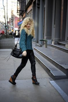 wedge boots with leather pants and knitted top