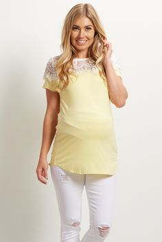 This beautiful basic will be your new go-to piece to this season. A solid short sleeve maternity top with a gorgeous lace neckline detail for a feminine look. Pair this top with maternity shorts and sandals and you're ready for anything.