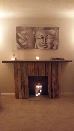 Pallet fireplace with reclaimed wood mantel